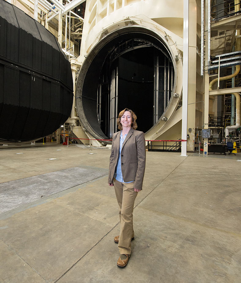 Warren in front of a vacuum chamber at NASA's Johnson Space Center