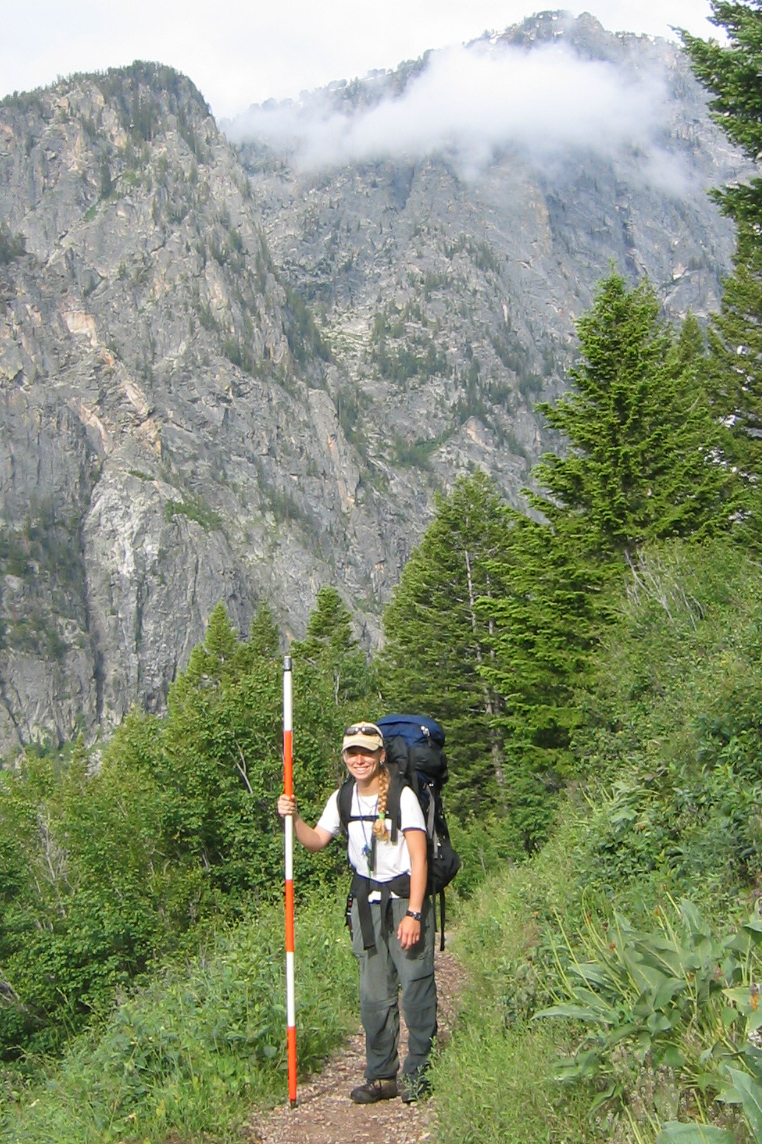 Jennifer Gremer stands while hiking a trail