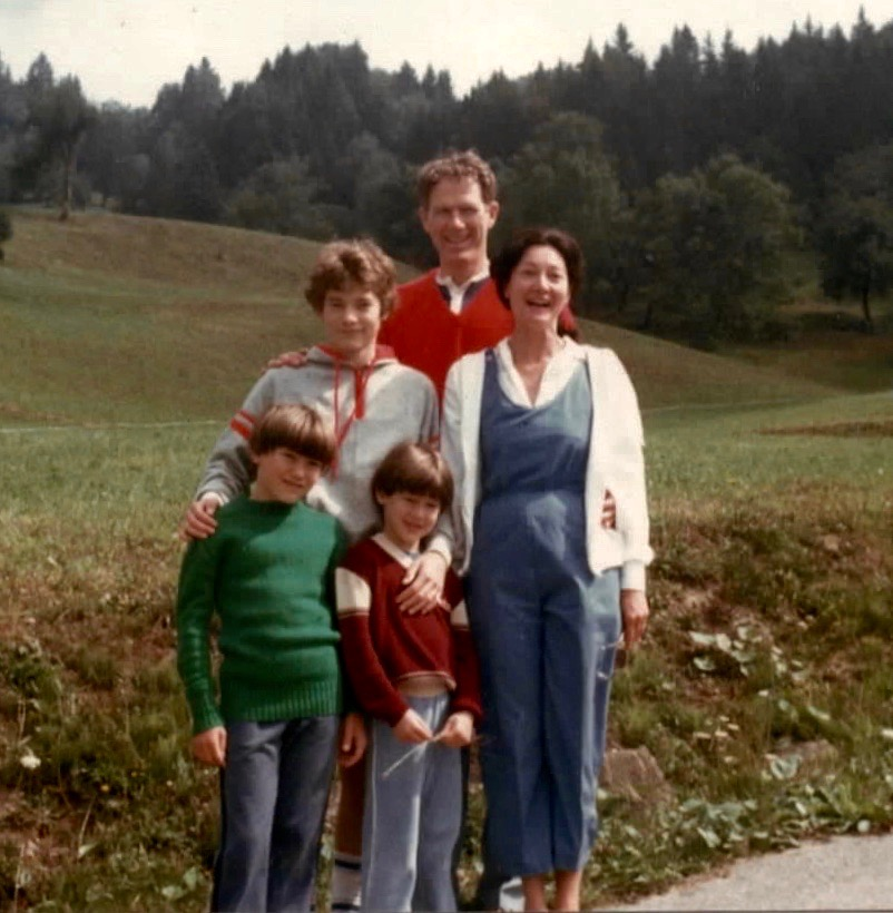 Lin and David Weaver stand with their family in the French Alps