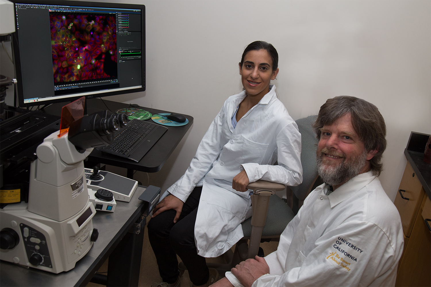 Bita Shahrvini (left) sits next to Assistant Professor Enoch Baldwin (right), who helped Sharhvini further her undergraduate research interest in enzymology, the study of enzymes. David Slipher/UC Davis