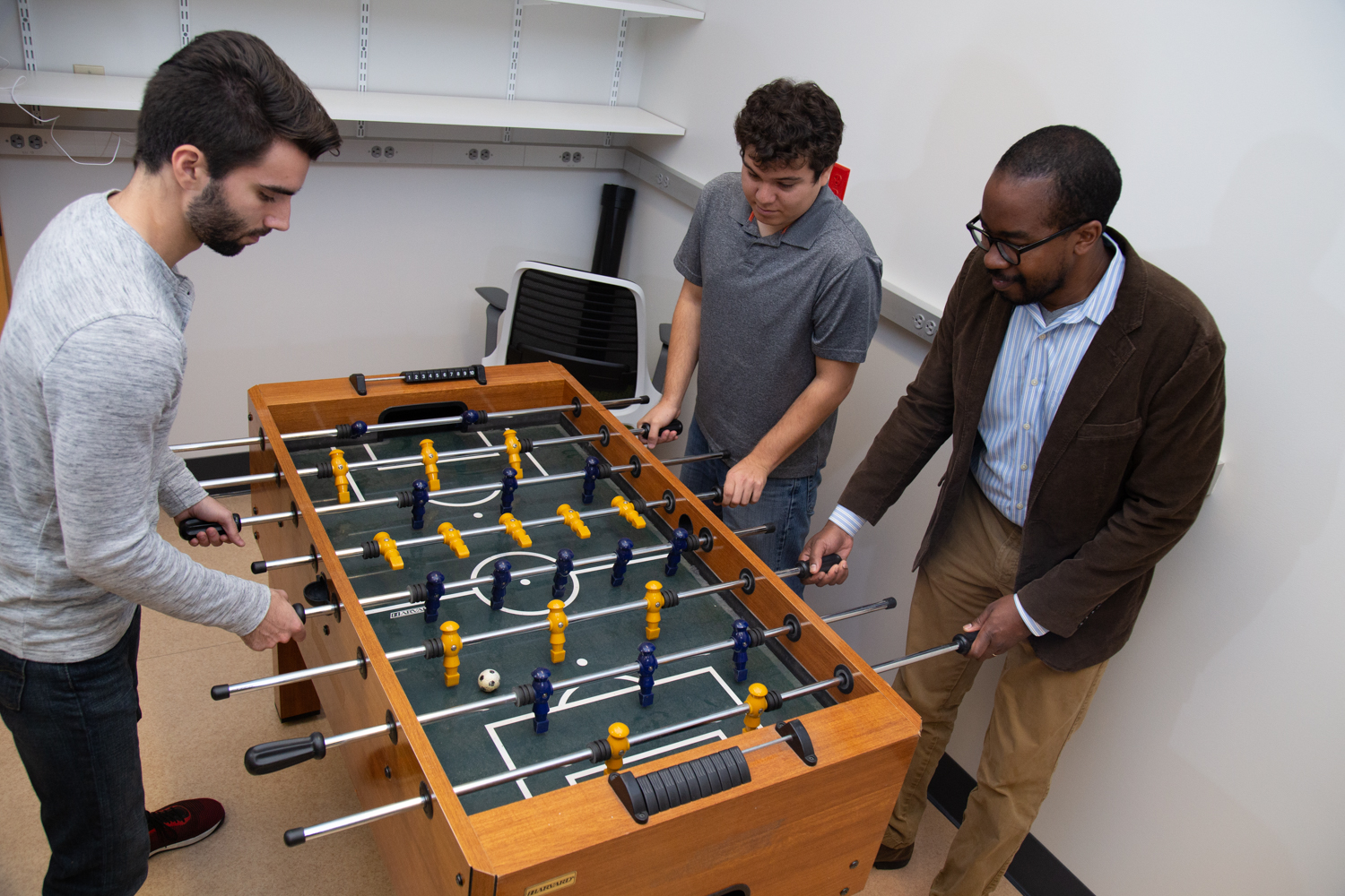 Wilsaan Joiner and lab members play some foosball