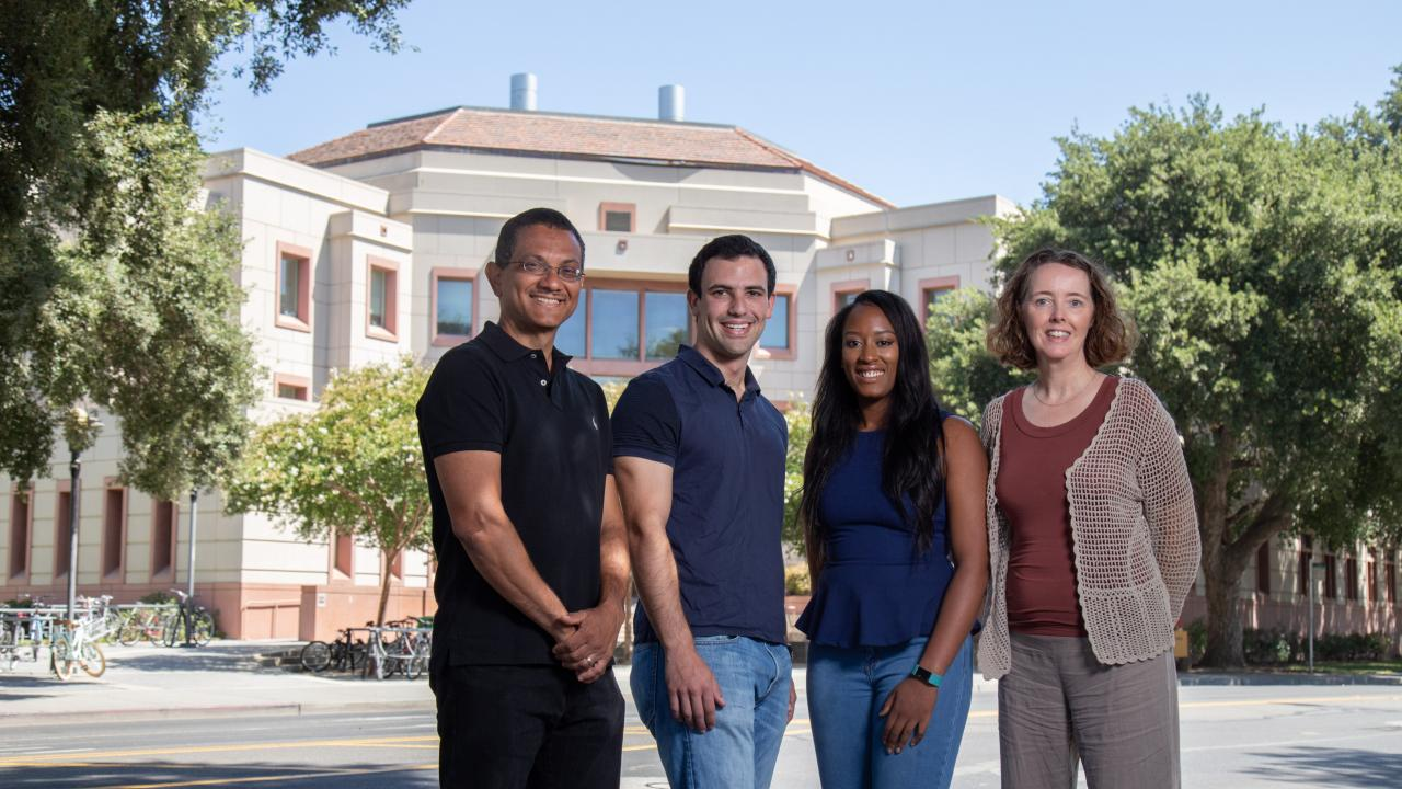 Aldrin Gomes, Leib Lipowsky, Tayler Smith and BUSP Director Connie Champagne stand outside the Life Sciences Building. David Slipher/UC Davis