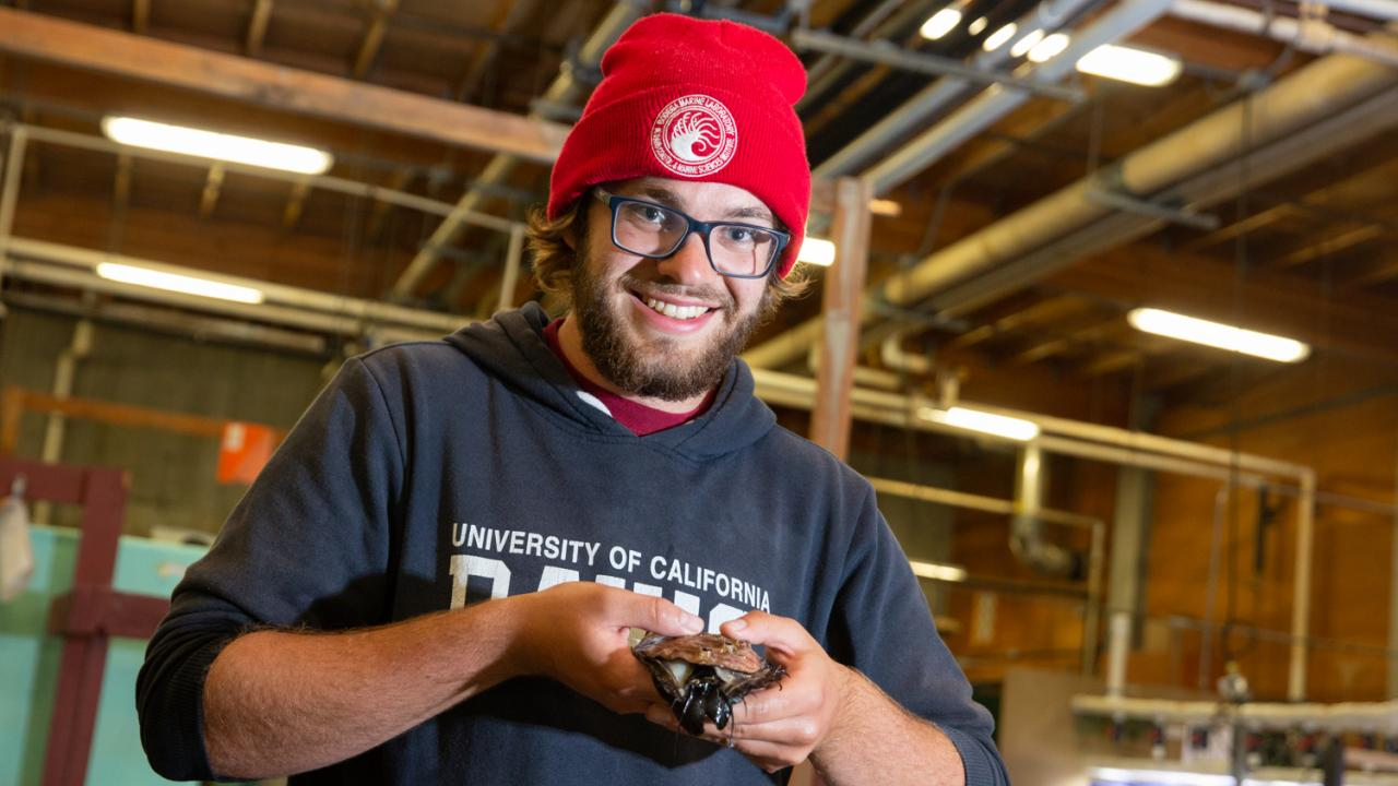 Evan Tjeerdema holds a red abalone