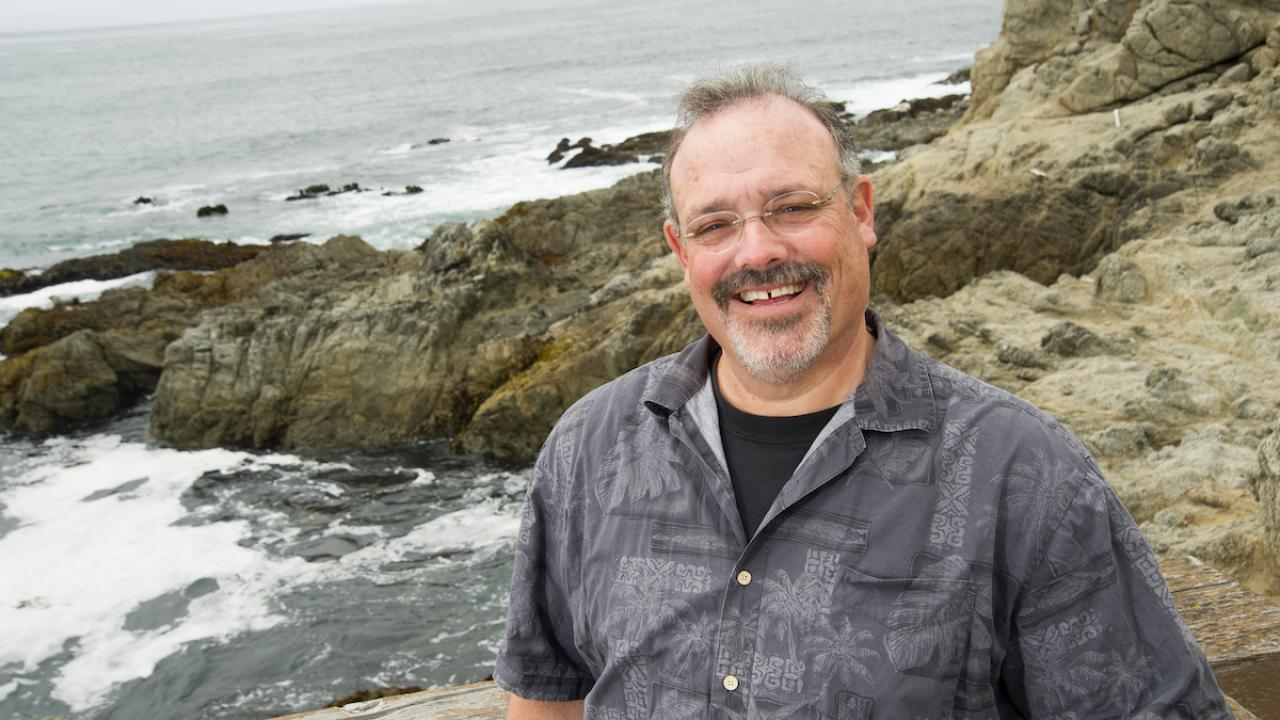 Gary Cherr Stands Near the Coast