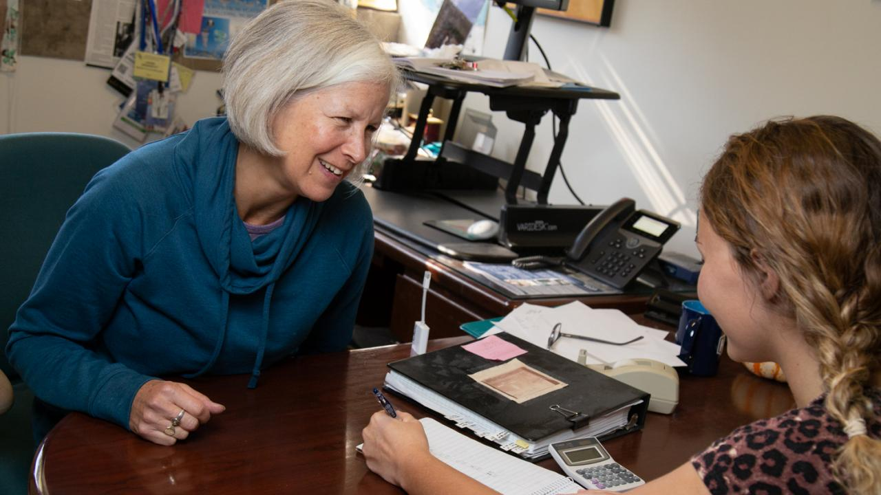 JoAnne Engebrecht talks with a student in her office