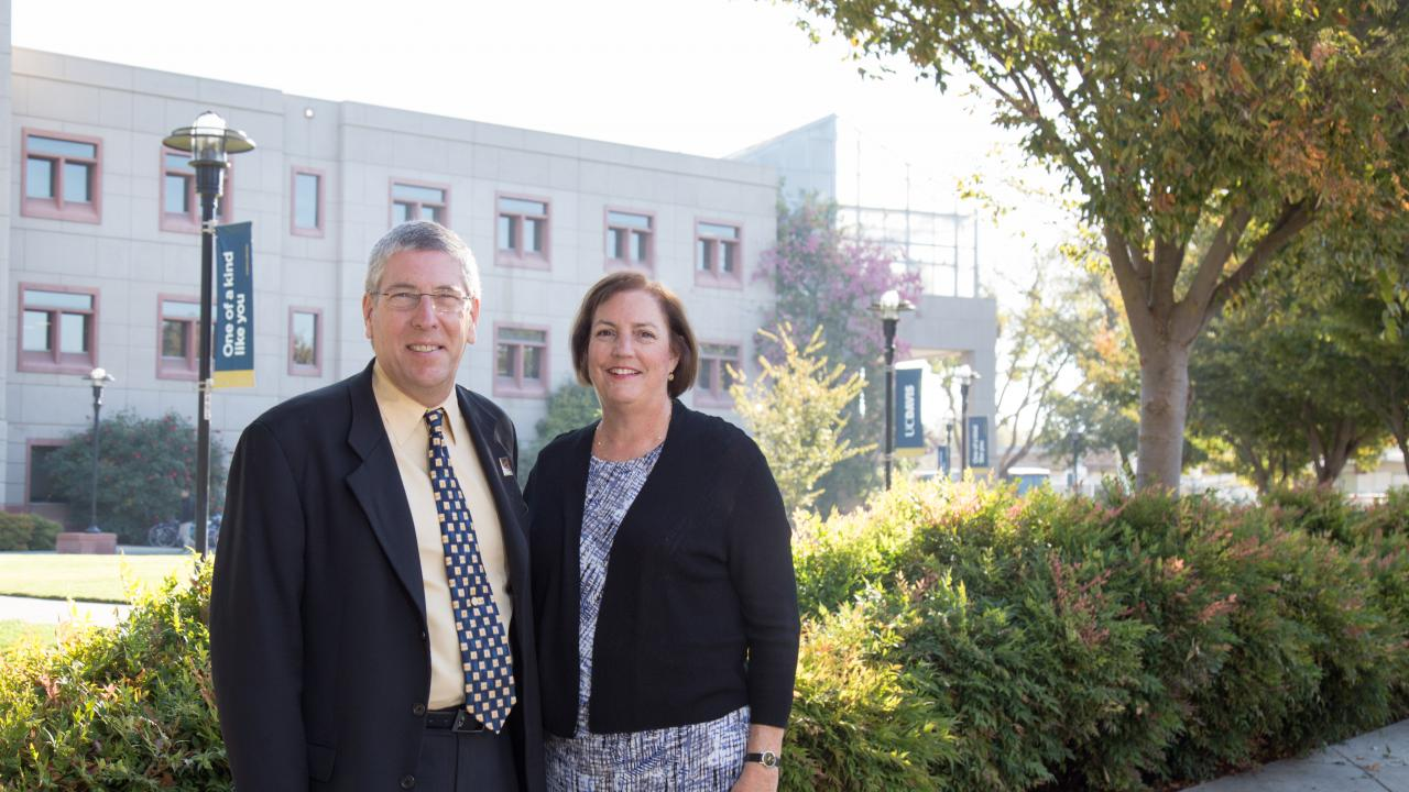 Deborah Neff '76 stands with College of Biological Sciences Dean Mark Winey. David Slipher/UCDavis