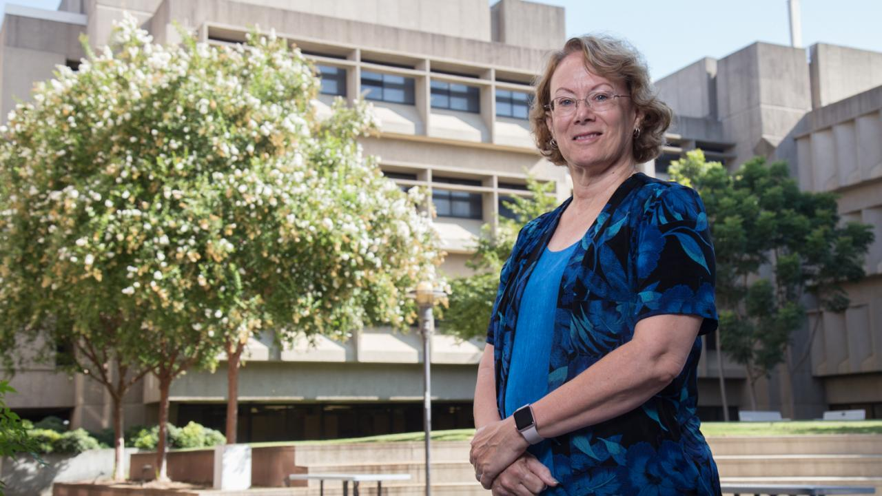 Michele Igo stands in the courtyard outside the Life Sciences Building