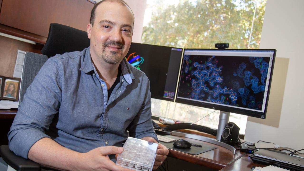 Assistant Professor Nitzan Shabek sits in his lab