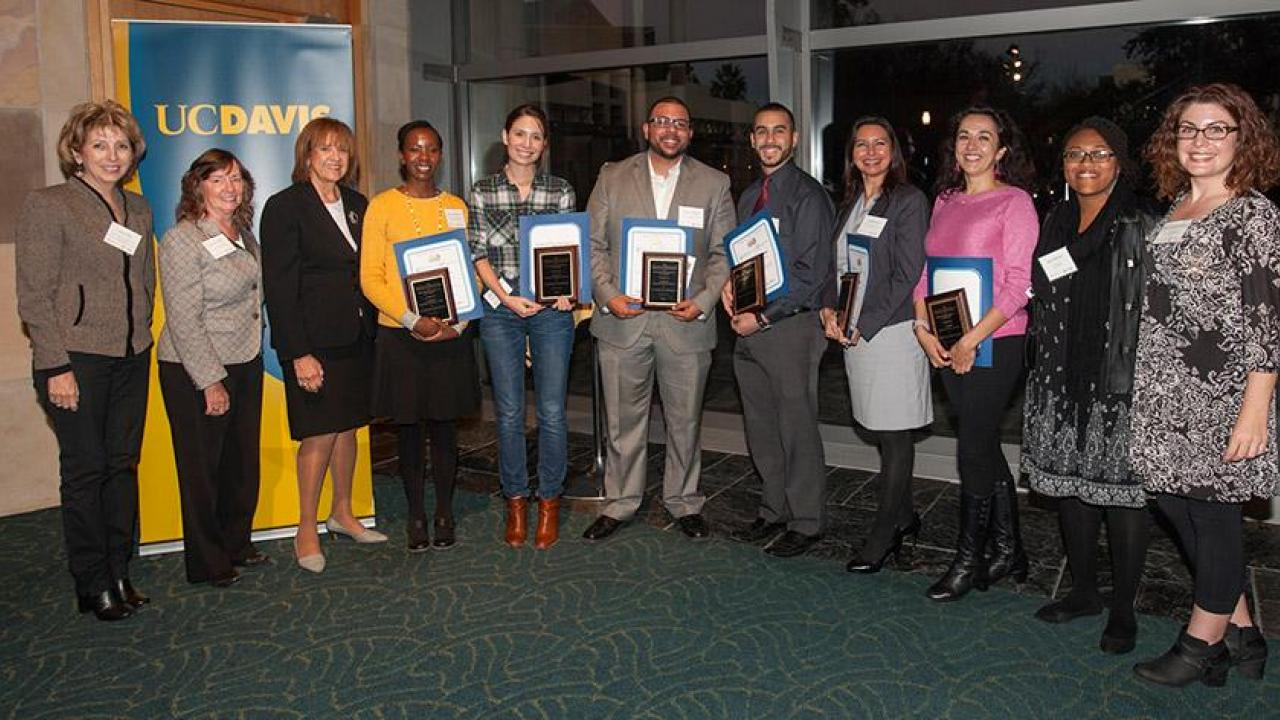 UC Davis' new CAMPOS Faculty Scholars (holding certificates and plaques), from left, Maureen Njoki Kinyua, Rebecca Hernandez, Jesús M. Velázquez, Samuel Díaz-Muñoz, Jeanette Ruiz and Verónica Martínez-Cerdeño. They are flanked by, from far left, Linda P.B. Katehi, chancellor emerita and UC Davis ADVANCE principal investigator; Karen McDonald, faculty director and co-principal investigator; and Mary Lou de Leon Siantz, CAMPOS founding director; and, at far right, 2015 CAMPOS Faculty Scholars Alexis Patterson