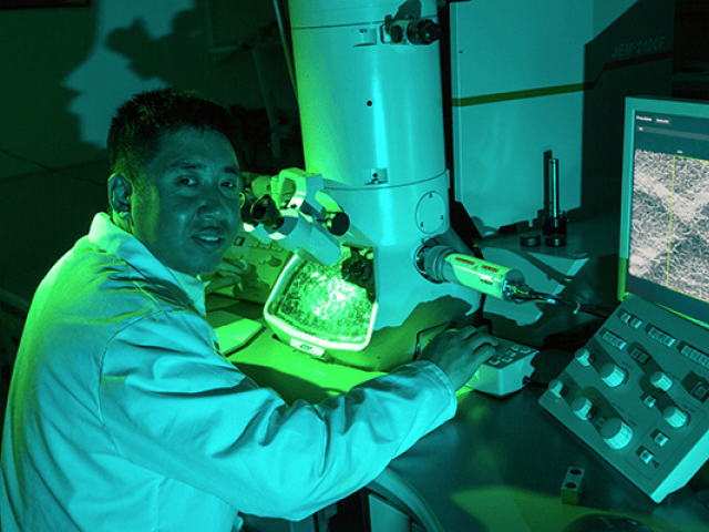 At the Biological Electron Microscopy Facility, researcher Fei Guo calibrates an electron microscope.