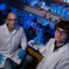 Professor Ken Kaplan and student Mackenzie Noon sit in the lab