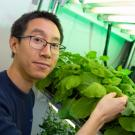 Patrick Shih with a plant