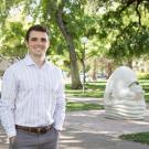 Senior Connor Grant stands next to one of UC Davis' famous Egghead statues.